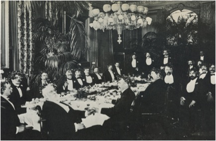 long table with people seated around