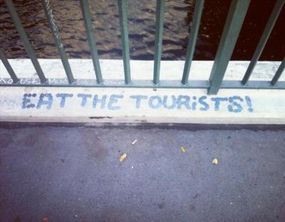 "Graffiti reading ""Eat the Tourists"""