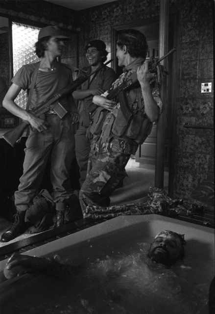 Soldiers laughing, a man in a bathtub