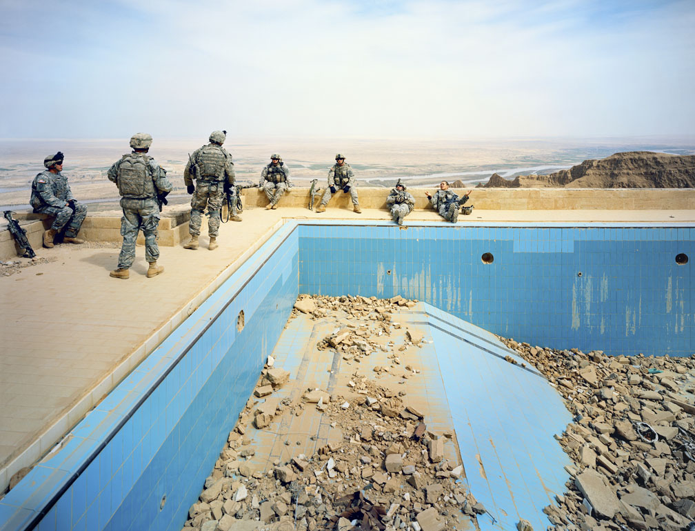Soldiers by an empty pool
