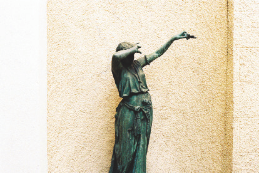 Statue covering its face with its arms