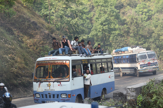 people on top of a bus