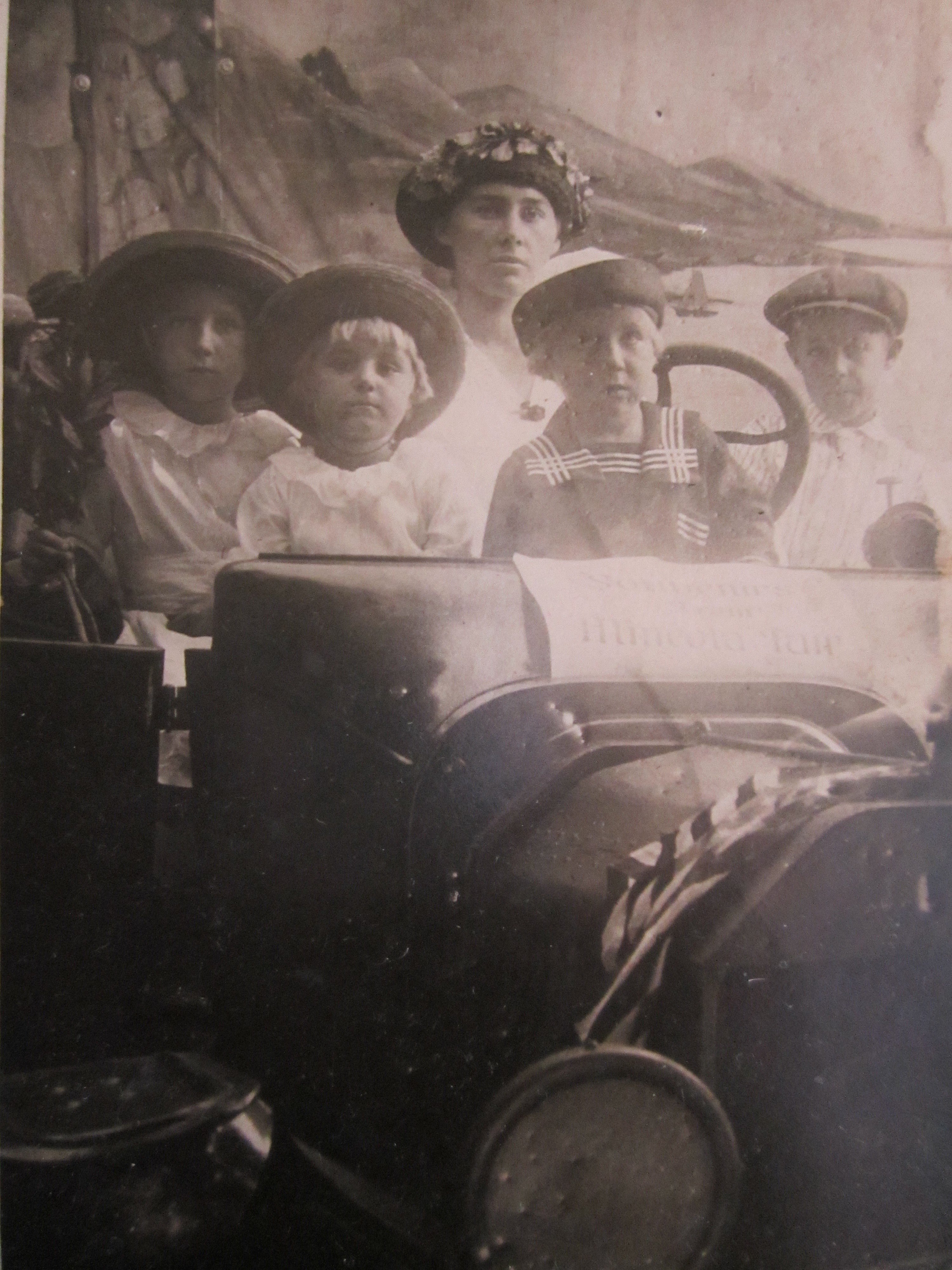 Stella's Children Look Out From a Photo Faded Gold