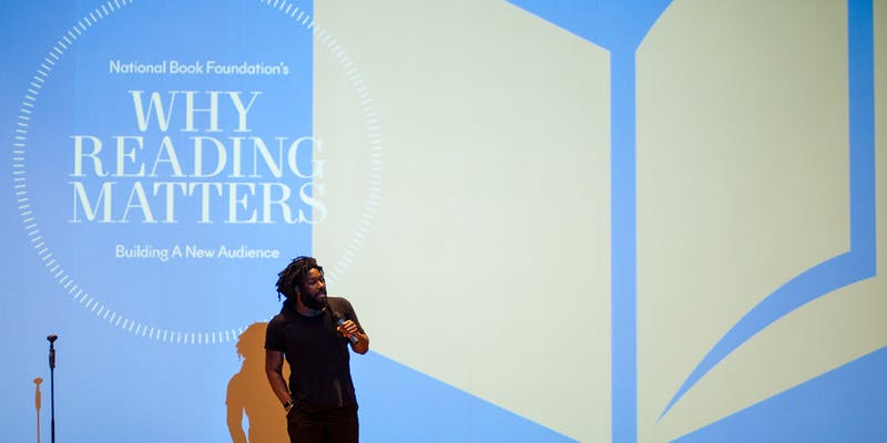 A man presents at a literary conference