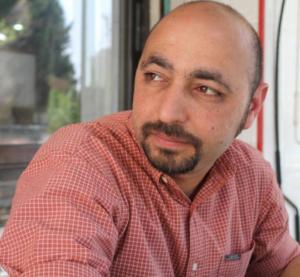 Headshot of Hisham Bustani