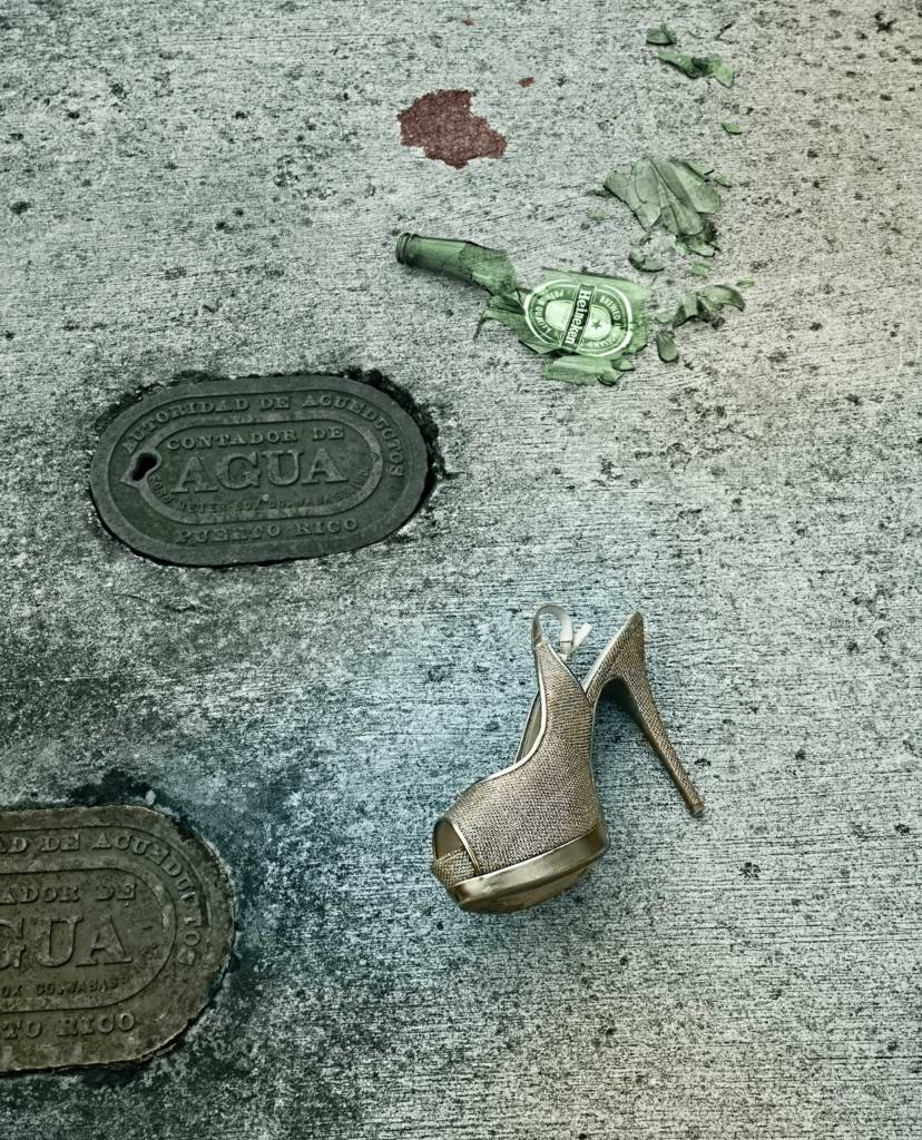 Shoe and a broken glass on sidewalk