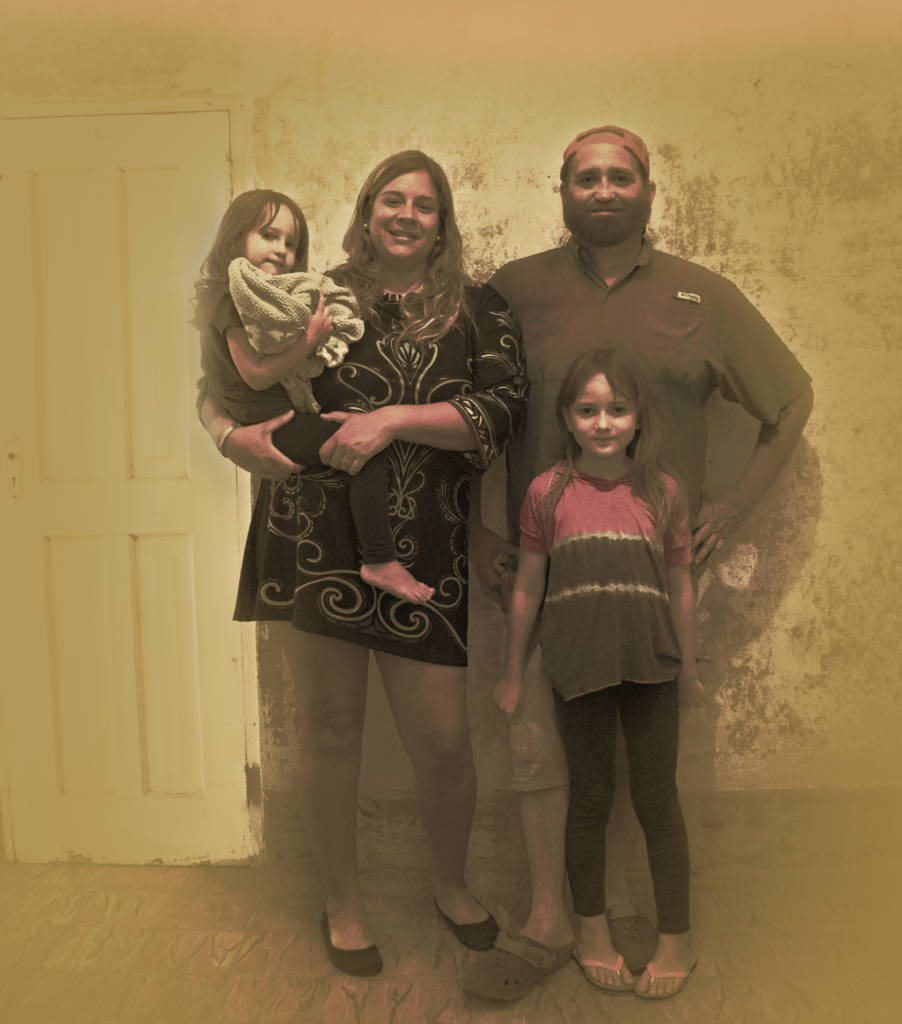 Photo of a family with two young girls