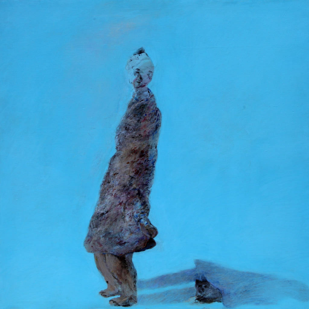 fuzzy figure on blue background