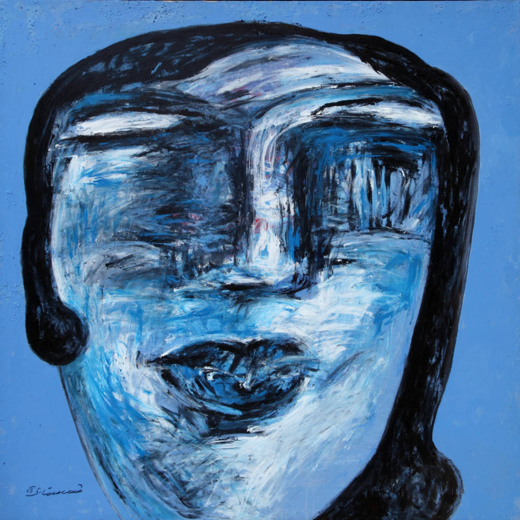 abstract face painted in blue