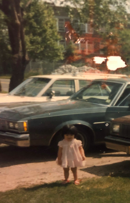 Image of girl standing next to car