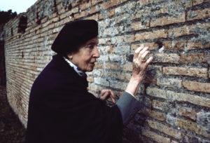 Image of woman touching wall