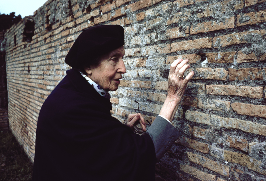 Image of woman touching wall