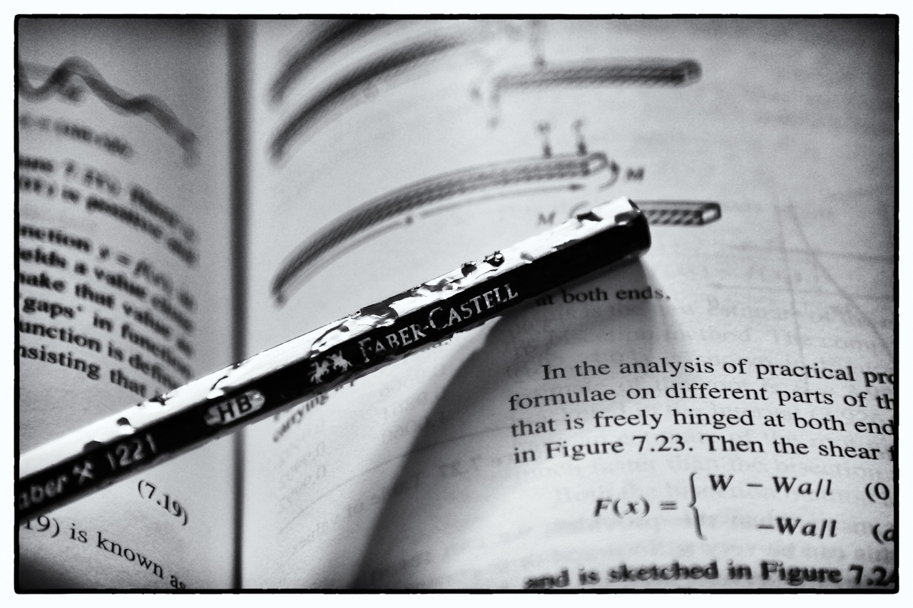 Pencil and textbook