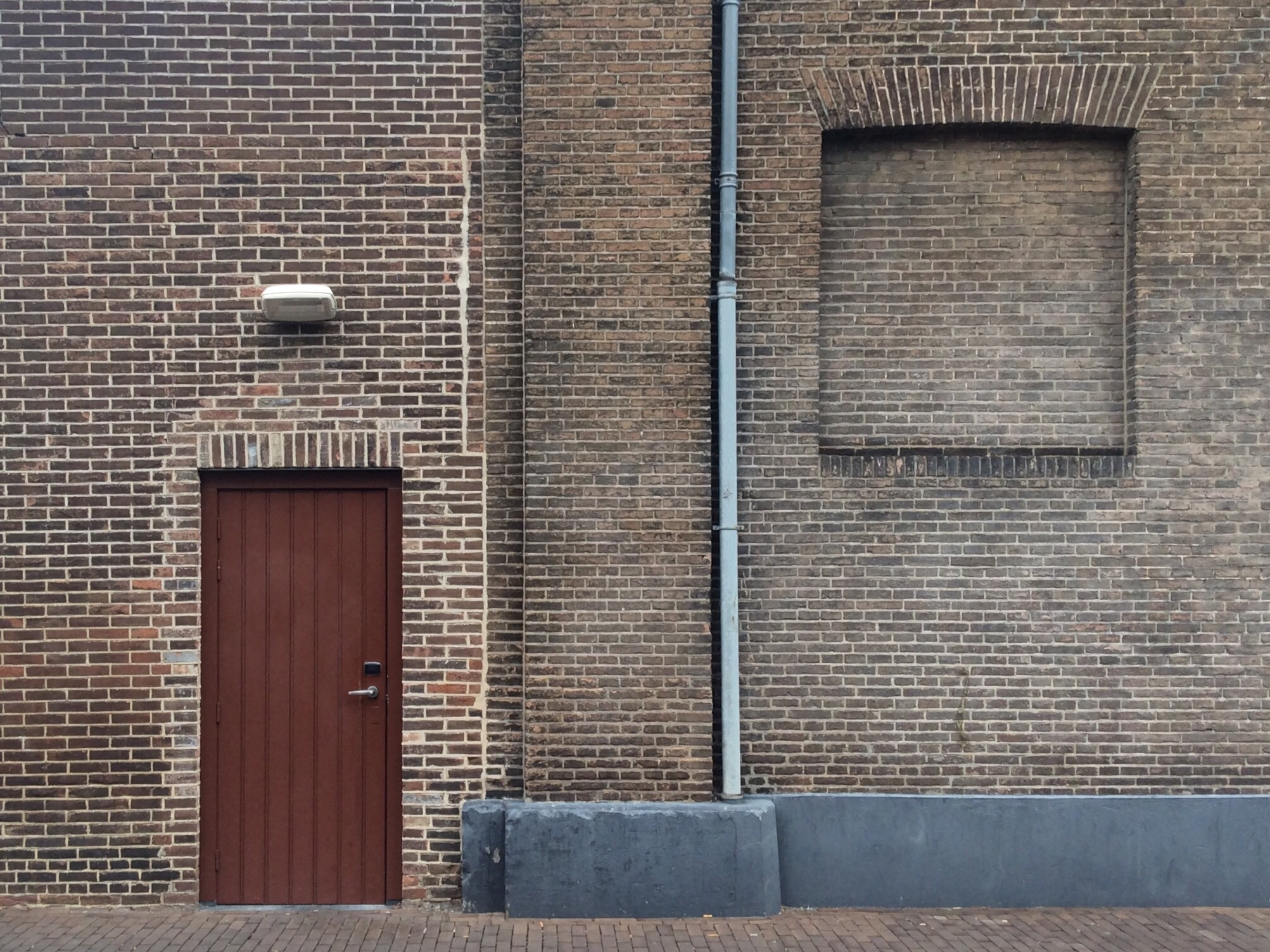 Photograph of a door in a brick wall from Joost Markerink on Flickr