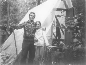 Image of people standing in front of a tent