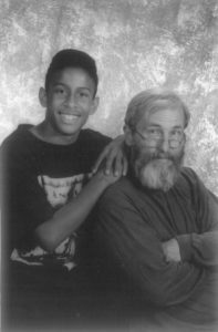 Image of a boy and his father seated