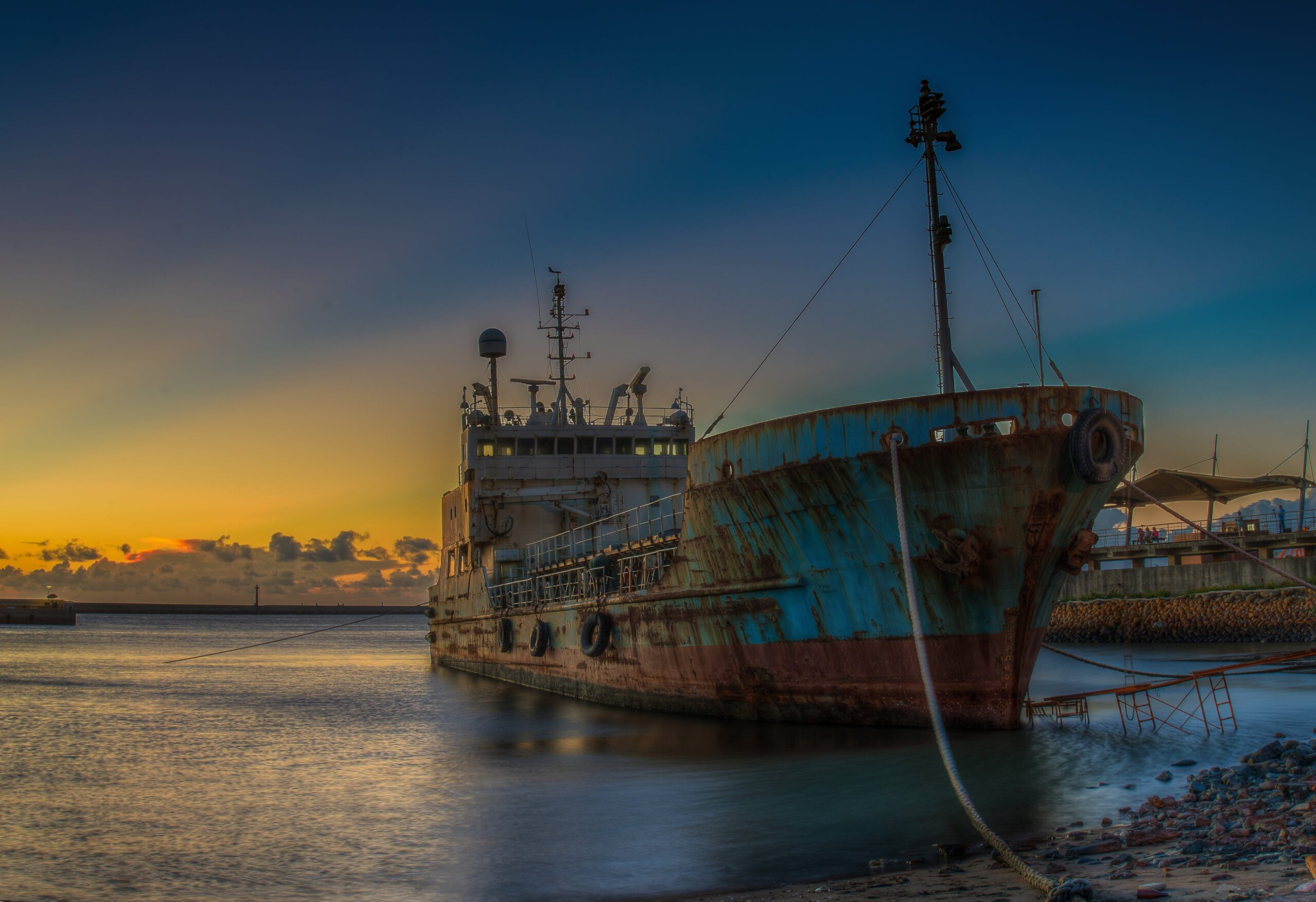 Old ship at sunset