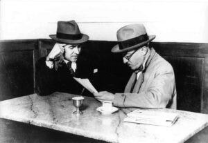 Image of two men sitting in a cafe.