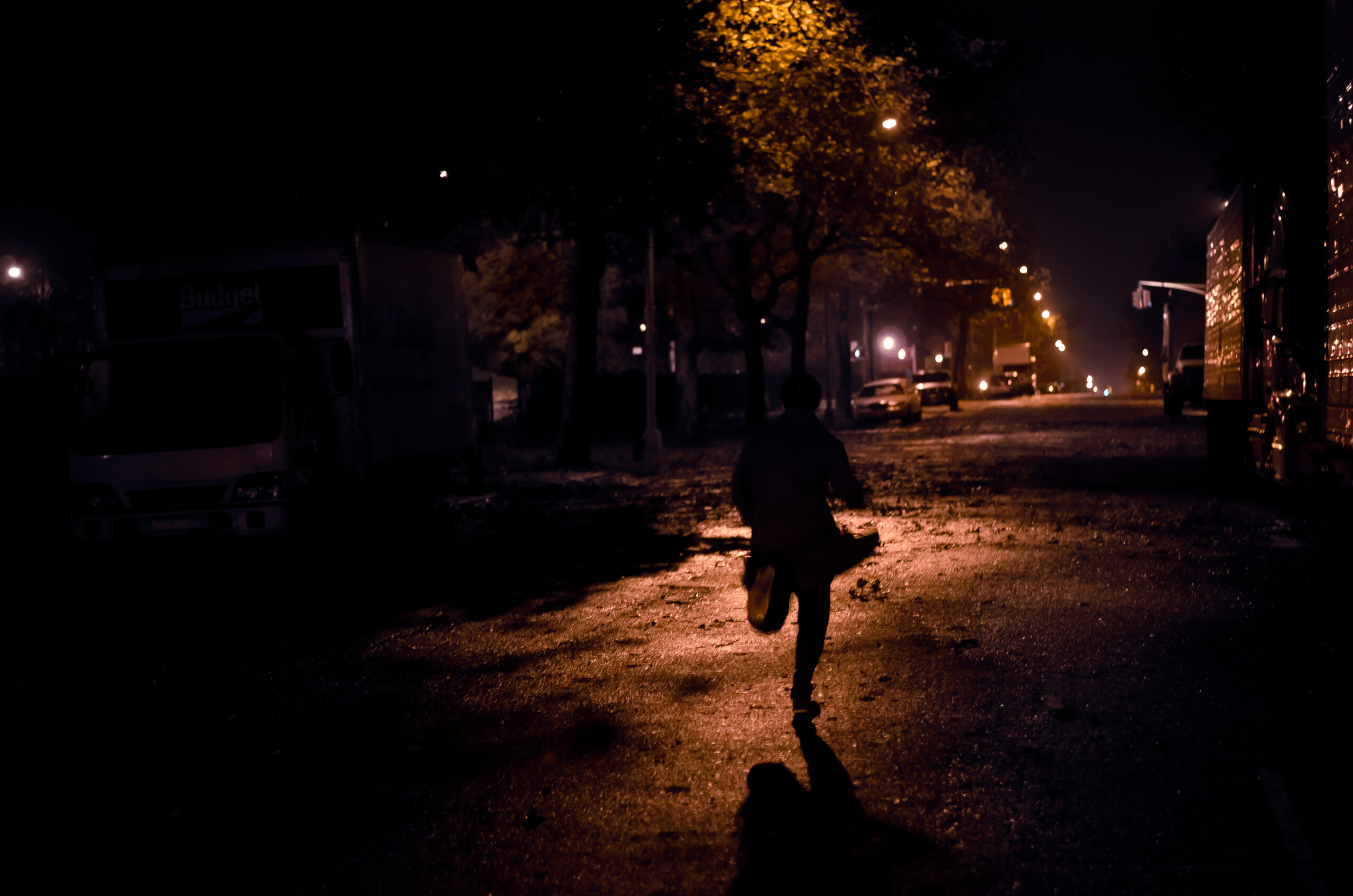 Image of man running away in the dark