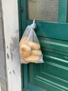 Image of bag of bread attached to the door (zoomed in)