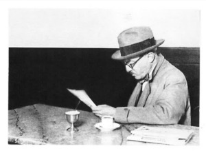 Image of a man sitting in a cafe