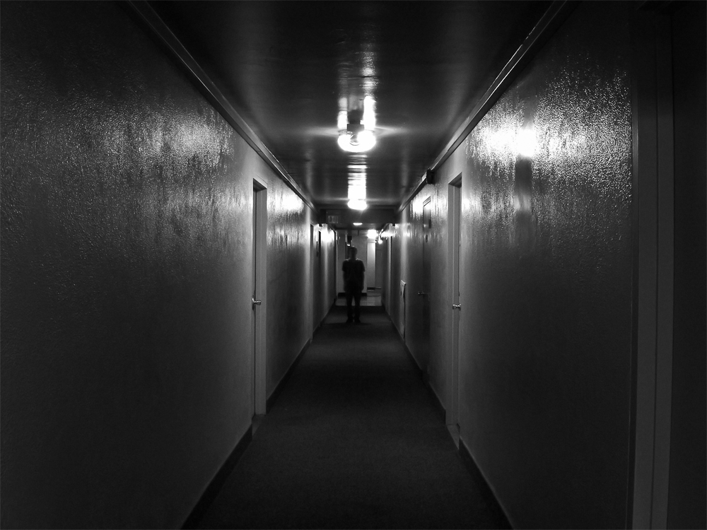 Image of a figure down the hallway.