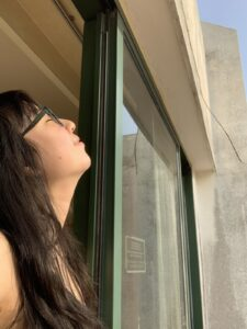 Image of woman looking out of the window.