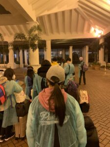 Image of people lined up in front of a hotel.