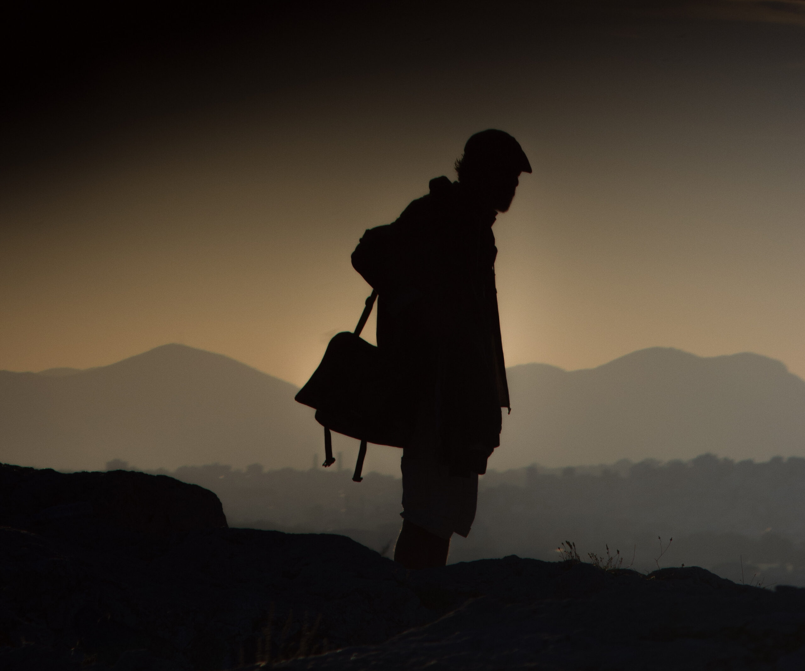Image of a man looking over mountains.