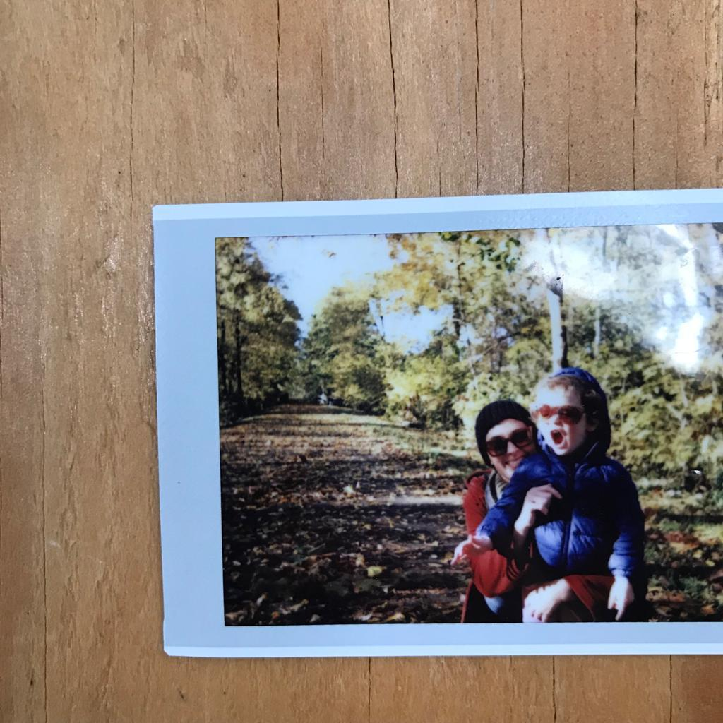 Image of a photo of two people in a park.