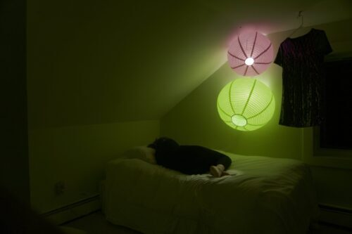 A person lying in bed in the dark
