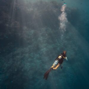 Image of person diving in the ocean