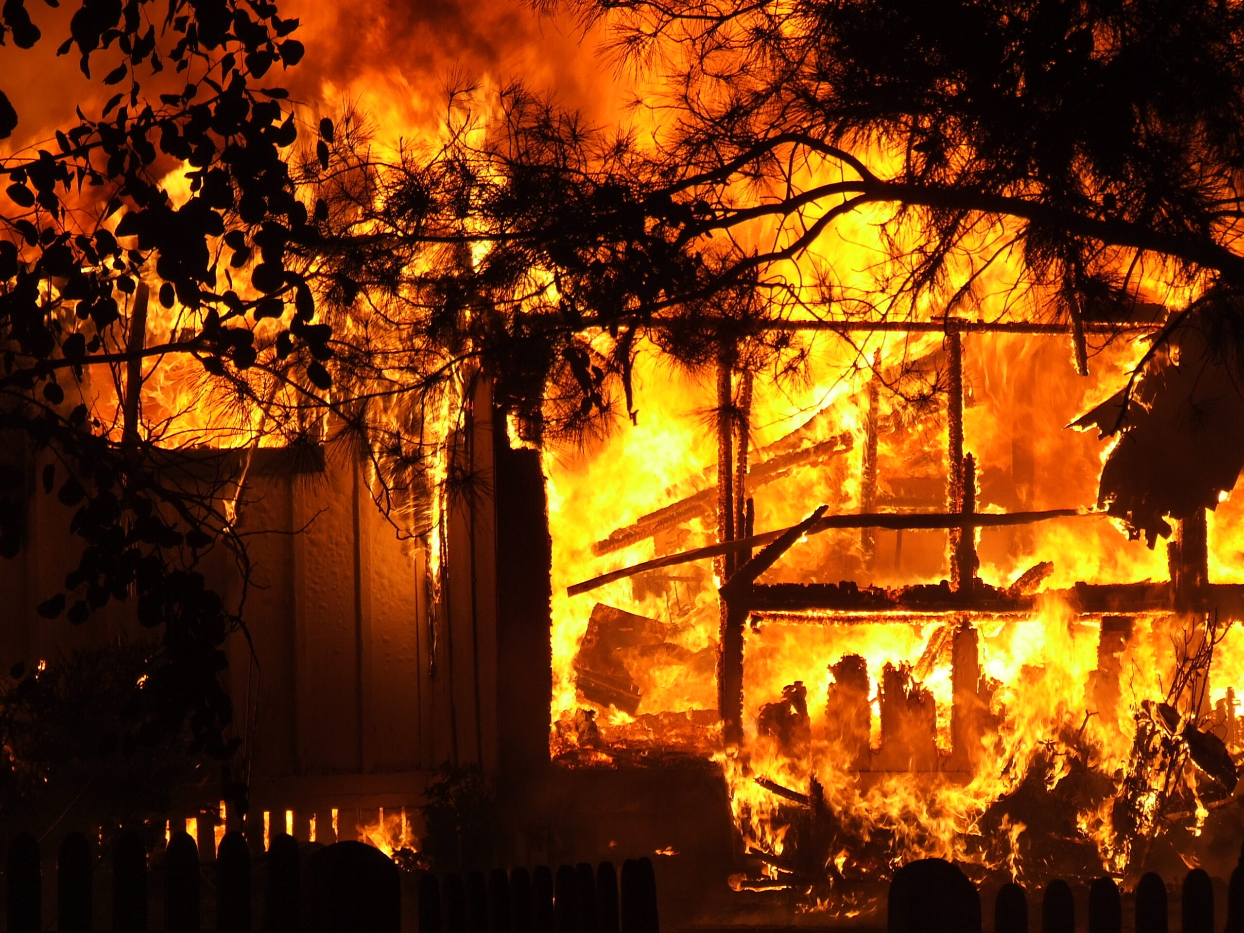 Image of the outline of a house in a fire.