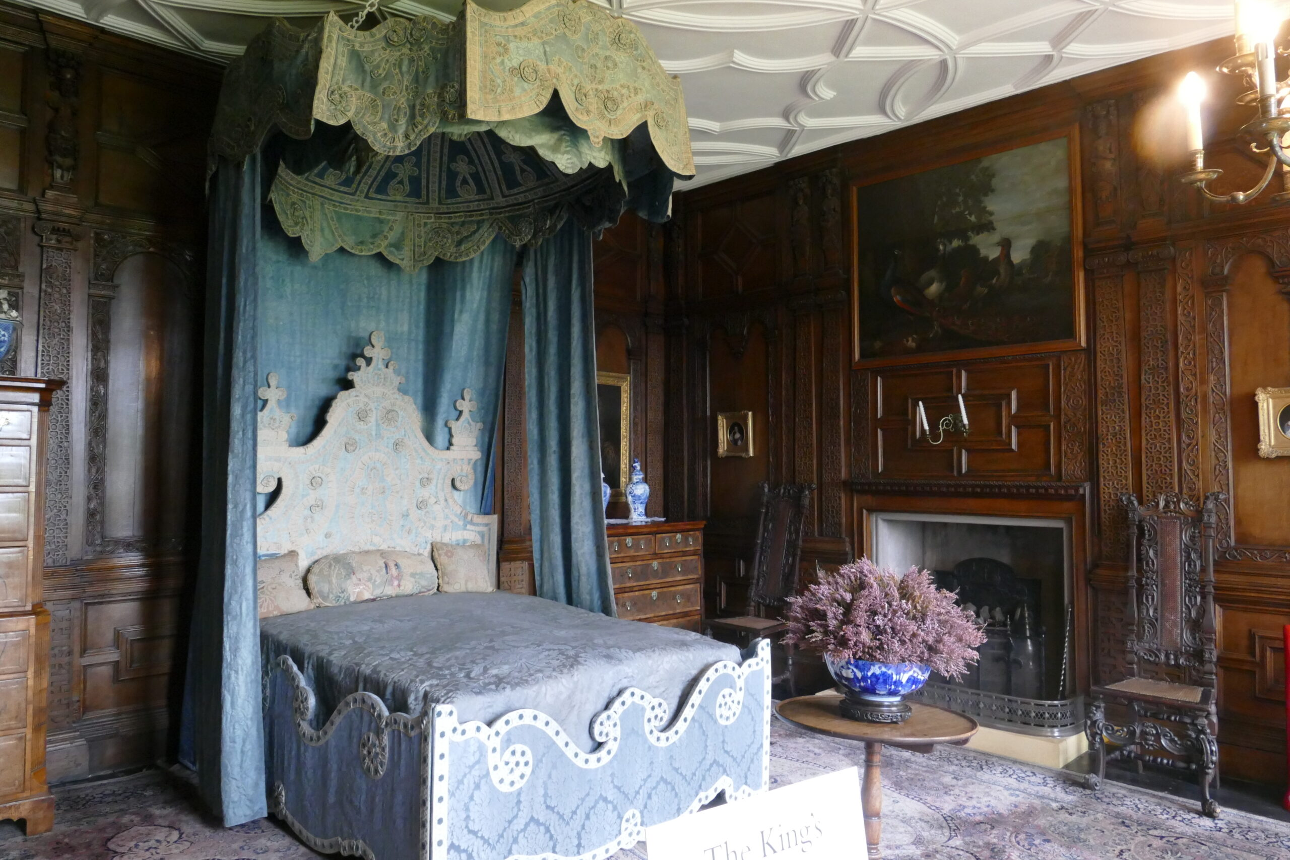 Image of an opulent bedroom with a canopy.