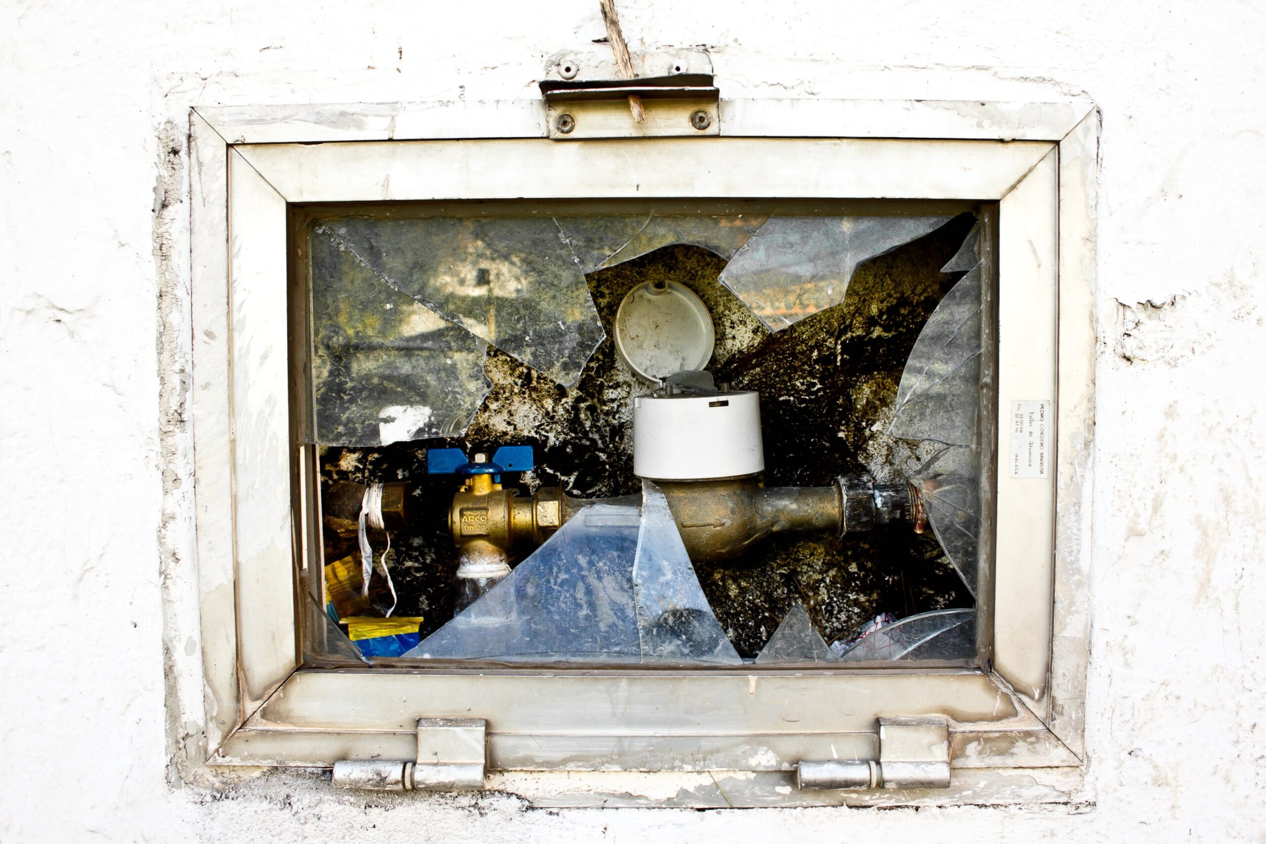 Image of objects under shards of broken glass.