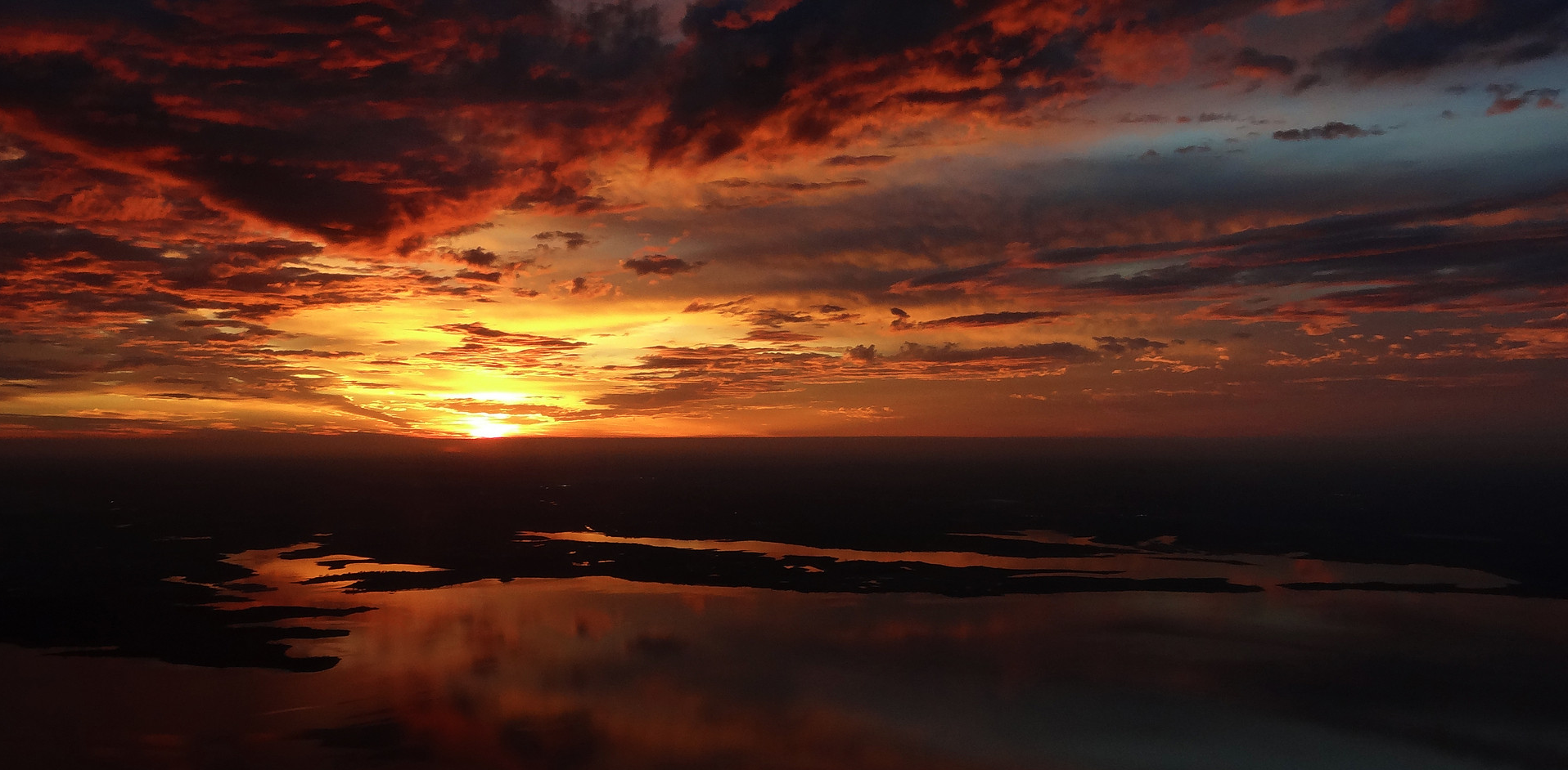 an image of a sunrise from above ground